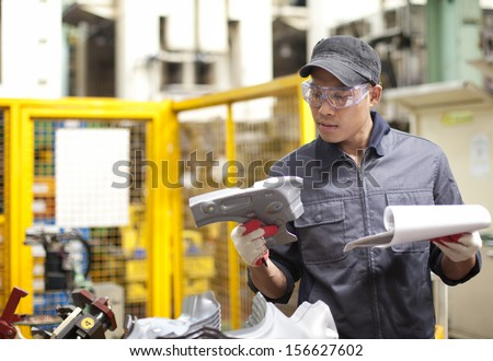 Mechanic worker checking for defects on metal  - stock photo