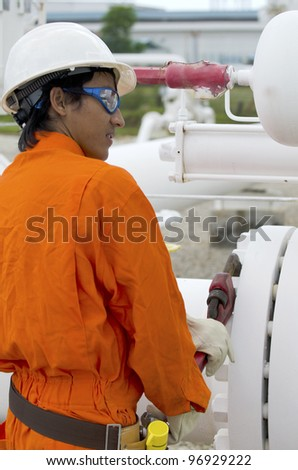 Mechanic worker is being work while to open bolt and nut of valve. - stock photo