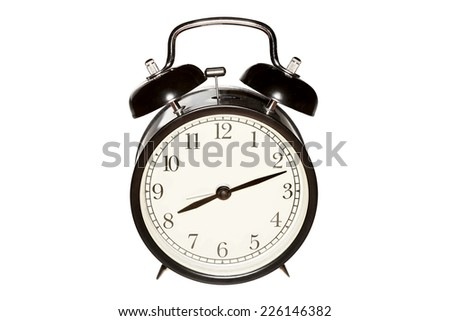 Mechanical alarm clock, isolated on the white. - stock photo