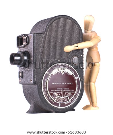 Mechanical Film Movie Camera with art doll isolated on white - stock photo