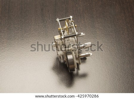 Mechanical gear  in a clock/Mechanical GearsClock mechanism which turns the gears on a clock - stock photo