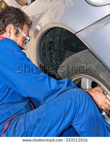 mechanical repairs tire of a car
