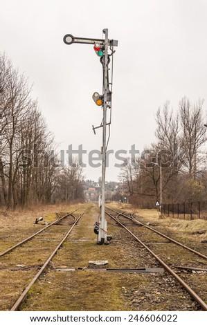 Mechanical semaphore signals near the railway tracks  - stock photo
