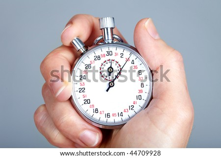 Mechanical stopwatch. Over grey background