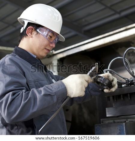 mechanical technician measuring detail after steel - stock photo