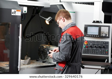 mechanical technician service engineer worker at cnc metal machining milling center in tool workshop