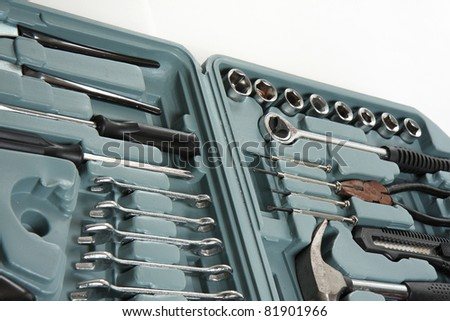 Mechanical tools arranged neatly in a toolbox. - stock photo