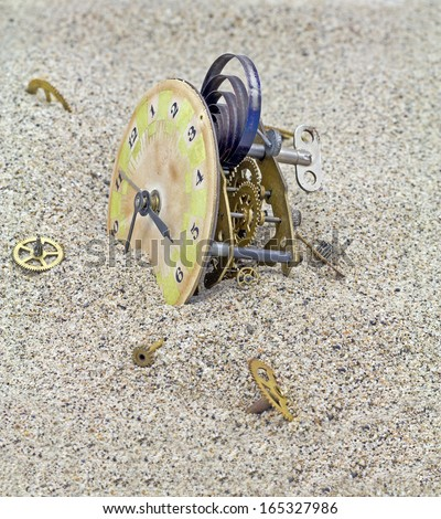 Mechanism of old clock pinions and covered with sand. - stock photo