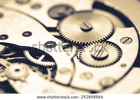 Mechanism of pocket watch with grunge texture. - stock photo