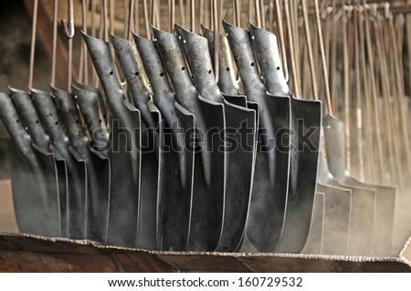 Mechanism steel shovel production line  - stock photo