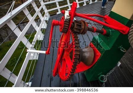 Mechanisms inside of windmill, Holland. - stock photo