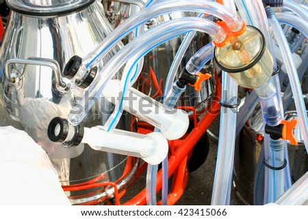 mechanized milking equipment - stock photo