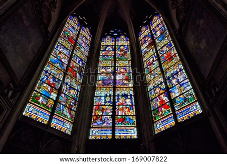 MECHELEN, BELGIUM-DECEMBER 29: Stained glass windows in St. Rumbold's Cathedral on December 29, 2013 in Mechelen, Belgium. This cathedral was consecrated in 1312 and has 97 meters tower. - stock photo