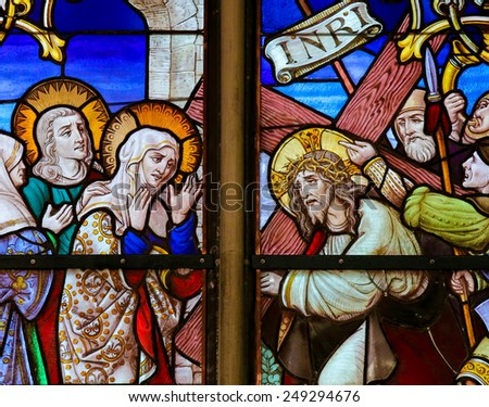 MECHELEN, BELGIUM - JANUARY 31, 2015: Stained Glass window depicting Jesus and Mary on the Via Dolorosa, in the Cathedral of Saint Rumboldt in Mechelen, Belgium. - stock photo