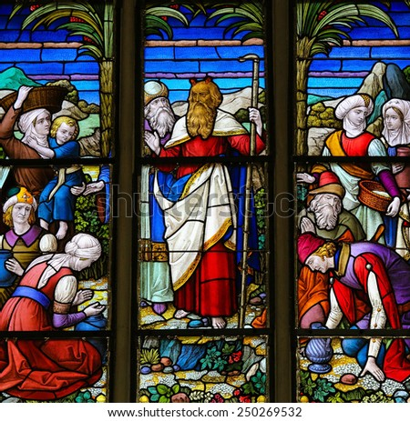 MECHELEN, BELGIUM - JANUARY 31, 2015: Stained Glass window depicting Moses in the Cathedral of Saint Rumbold in Mechelen, Belgium. - stock photo