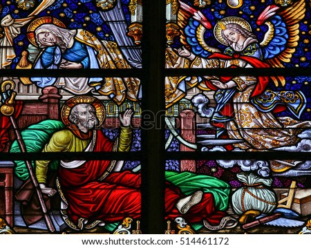 MECHELEN, BELGIUM - JANUARY 31, 2015: Stained Glass window depicting the Dream of Saint Joseph, in the Cathedral of Saint Rumboldt in Mechelen, Belgium.