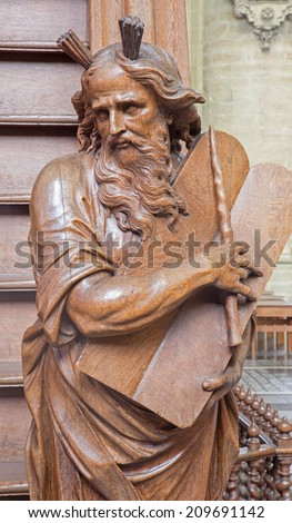 MECHELEN, BELGIUM - JUNE 14, 2014: The carved statue of Moses on the entry of the pulpit by  Willem Ignatius Kerrickx (1718) in church Our Lady across de Dyle.  - stock photo