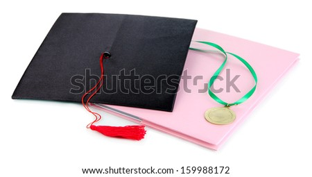 Medal for achievement in education, hat and notebook isolated on white