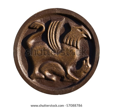 Medallion with ancient Slavic designs over white - stock photo