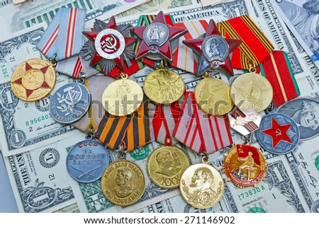 Medals and orders of the Great Patriotic War on dollars background - stock photo