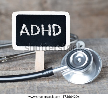 Medecine concept. Blackboard with word ADHD and stethoscope - stock photo