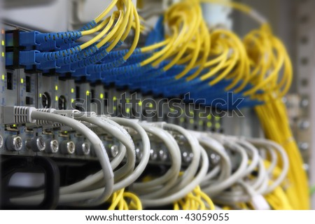 Media Converters. Fiber Optic cables connected to an optic ports and UTP Network cables connected to an Fast/Giga ethernet ports. Data Network Hardware Concept. SC/UPC connectors. - stock photo