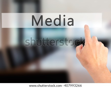 Media - Hand pressing a button on blurred background concept . Business, technology, internet concept. Stock Photo