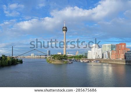 Media Harbor in Dusseldorf with Rheinturm TV tower and Buildings of Neuer Zollhof, Germany - stock photo