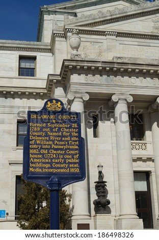 MEDIA, PENNSYLVANIA - March 6, 2014: A historical landmark sign marks the founding of Delaware County in 1789 outside the county courthouse, one of the first public buildings in American history.   - stock photo