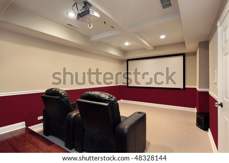 Media room in luxury home with home theater chairs - stock photo