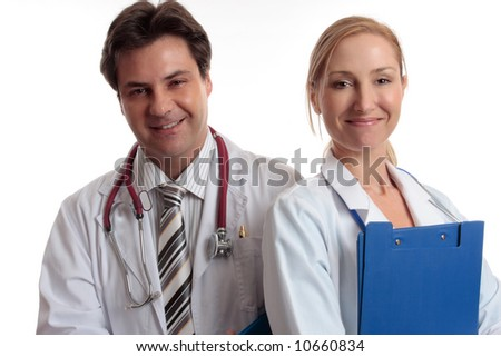 Medical Assistance.  Male and female medical personnel standing together smiling. - stock photo