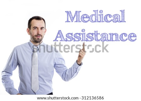 Medical Assistance - Young businessman with small beard pointing up in blue shirt - stock photo