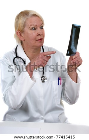 medical assistant holds an x-ray image for review