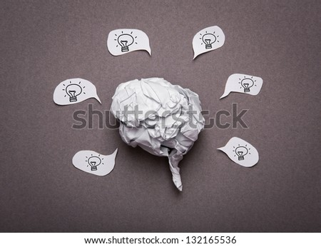 Medical background, Crumpled paper brain shape with light bulb - stock photo