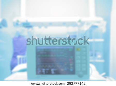 Medical background with a monitor in a hospital ward. Blurred healthcare background - stock photo