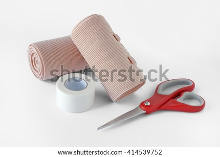 Medical bandage rolls, bandage, elastic , Scissors, screw, scotch tape, first aid supplies, a white background. - stock photo