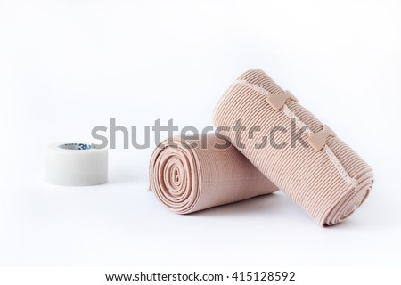 Medical bandage rolls, bandage, elastic ,  scotch tape, first aid supplies, a white background. - stock photo