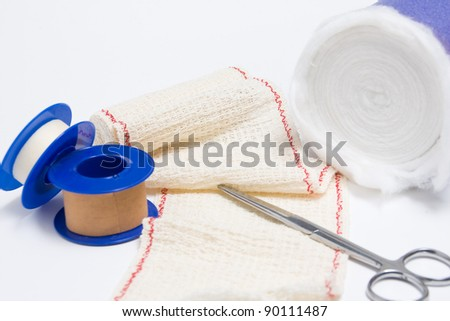 Medical bandage scissors together, tape and cotton