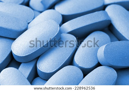 Medical blue pills macro background