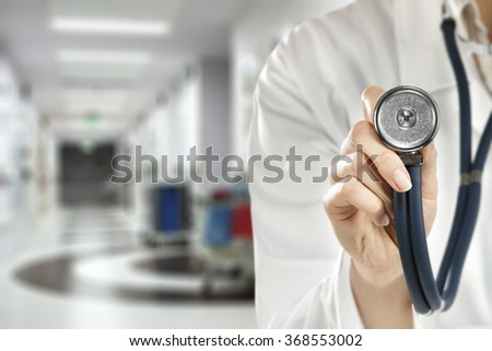 medical blurred background of hospital interior and closeup of stethoscope