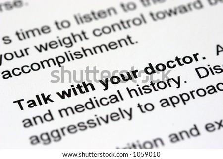 Medical Book diagonal with narrow depth of focus - stock photo