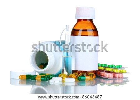 Medical bottles, ampoule and pills isolated on white - stock photo