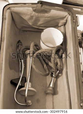 medical Briefcase with antique medical instruments and an old stethoscope