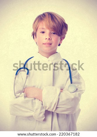 Medical child with arms crossed - stock photo