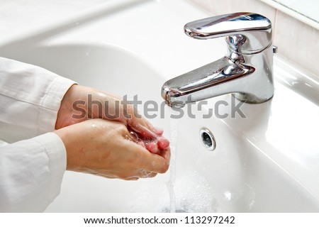 Medical cleanup - Washing hands - stock photo