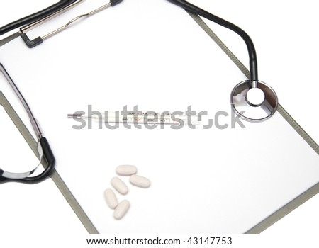 Medical clipboard and thermometer - stock photo
