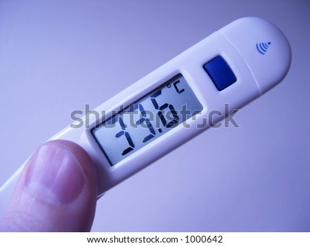 Medical close up of digital thermometer with centigrade readout with a cool blue tint