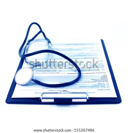 Medical concept : stethoscope and medical form on clipboard. Shallow dof.
