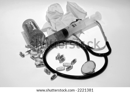 medical dental concepts with real human teeth, pills, hypodermic needle with green fluid, and a stethascope in black and white