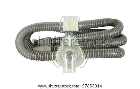 Medical device known as (CPAP) continuous positive airway pressure- mask and hose isolated on white background - stock photo